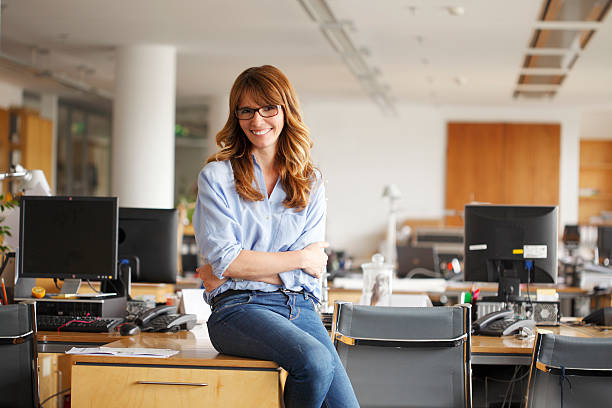 Mature businesswoman in office stock photo