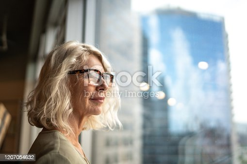 Mature businesswoman looking out of window