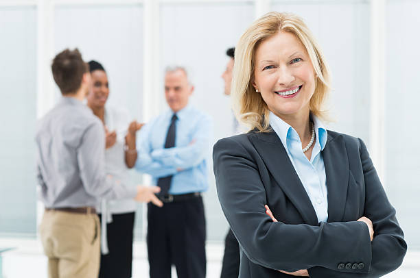 mature businesswoman - incidental people stock pictures, royalty-free photos & images