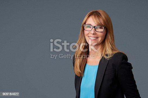 istock Mature businesswoman portrait 909184622
