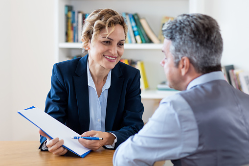 istock Mature businesswoman showing contract to new employee 1149125397