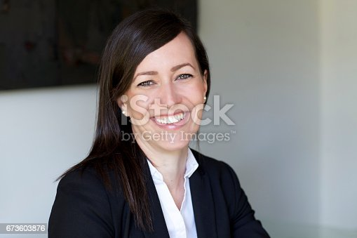 625010932istockphoto Mature Businesswoman Smiling At The Camera. Working At Home. 673603876