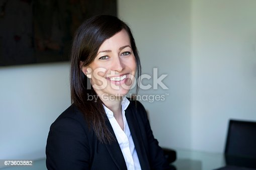 625010932istockphoto Mature Businesswoman Smiling At The Camera. Working At Home. 673603882