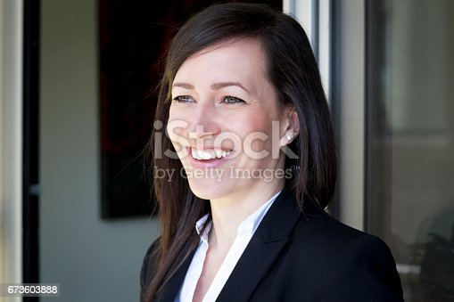625010932istockphoto Mature Businesswoman Smiling At The Camera. Working At Home. 673603888