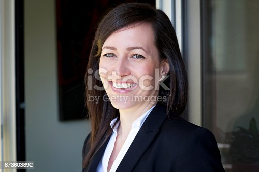 625010932istockphoto Mature Businesswoman Smiling At The Camera. Working At Home. 673603892