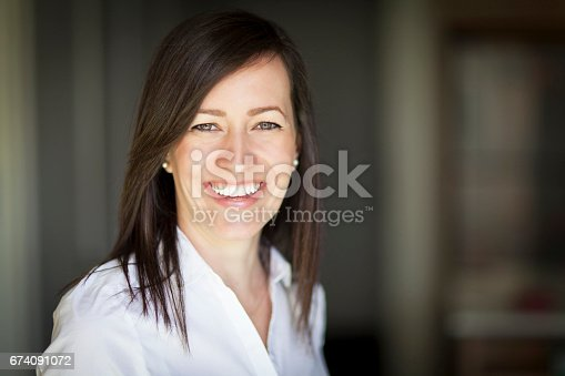 625010932istockphoto Mature Businesswoman Smiling At The Camera. Working At Home. 674091072
