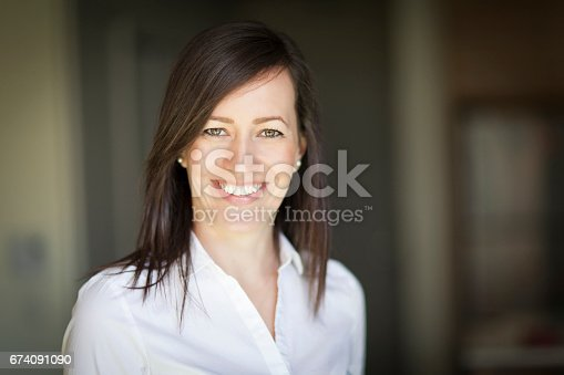 625010932istockphoto Mature Businesswoman Smiling At The Camera. Working At Home. 674091090
