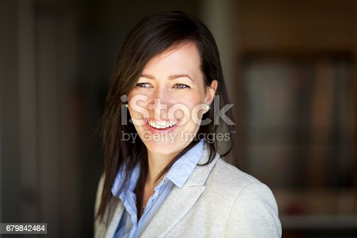 625010932istockphoto Mature Businesswoman Smiling At The Camera. Working At Home. 679842464