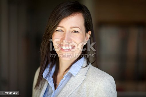 625010932istockphoto Mature Businesswoman Smiling At The Camera. Working At Home. 679842468