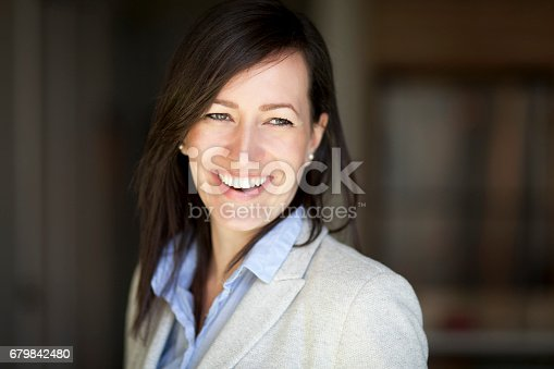 625010932istockphoto Mature Businesswoman Smiling At The Camera. Working At Home. 679842480