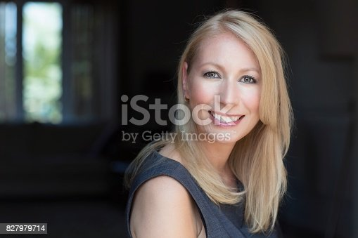 625010932istockphoto Mature Businesswoman Smiling At The Camera. Working At Home. 827979714