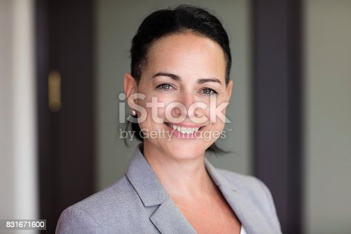 625010932istockphoto Mature Businesswoman Smiling At The Camera. Working At The Office 831671600