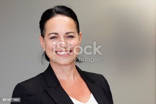 625010932istockphoto Mature Businesswoman Smiling At The Camera. Working At The Office 831671692