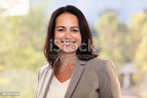 625010932istockphoto Mature Businesswoman Smiling At The Camera. Working At The Office 831671736