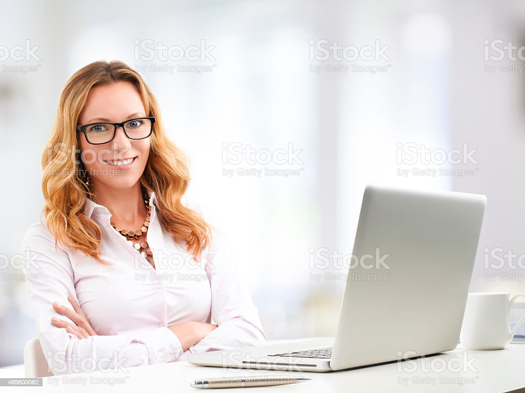 A mature businesswoman using a laptop royalty-free stock photo