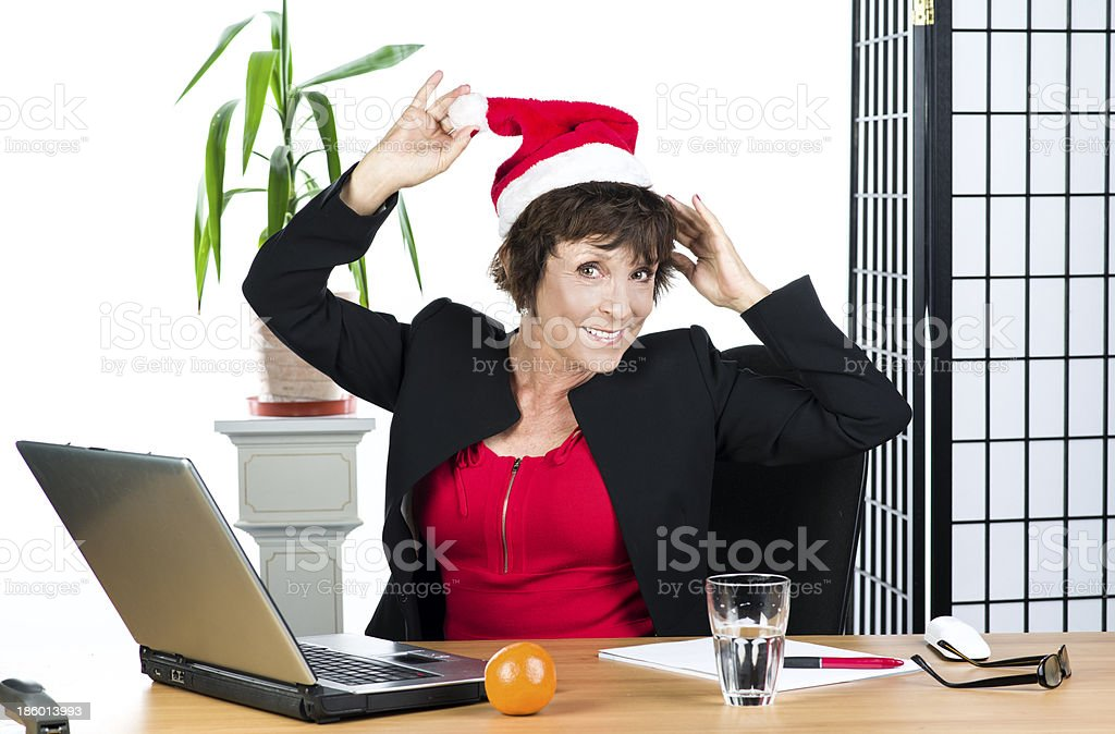 Mature businesswoman with Christmas hat royalty-free stock photo