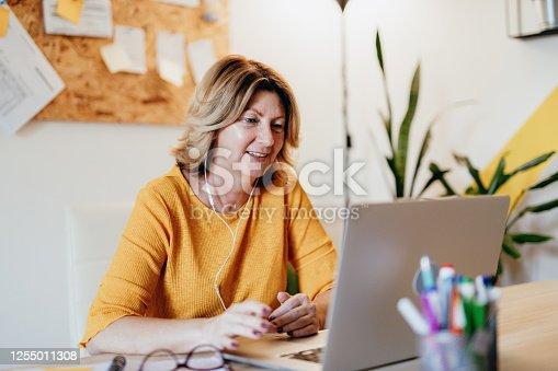 Mature businesswoman working from home during coronavirus pandemic