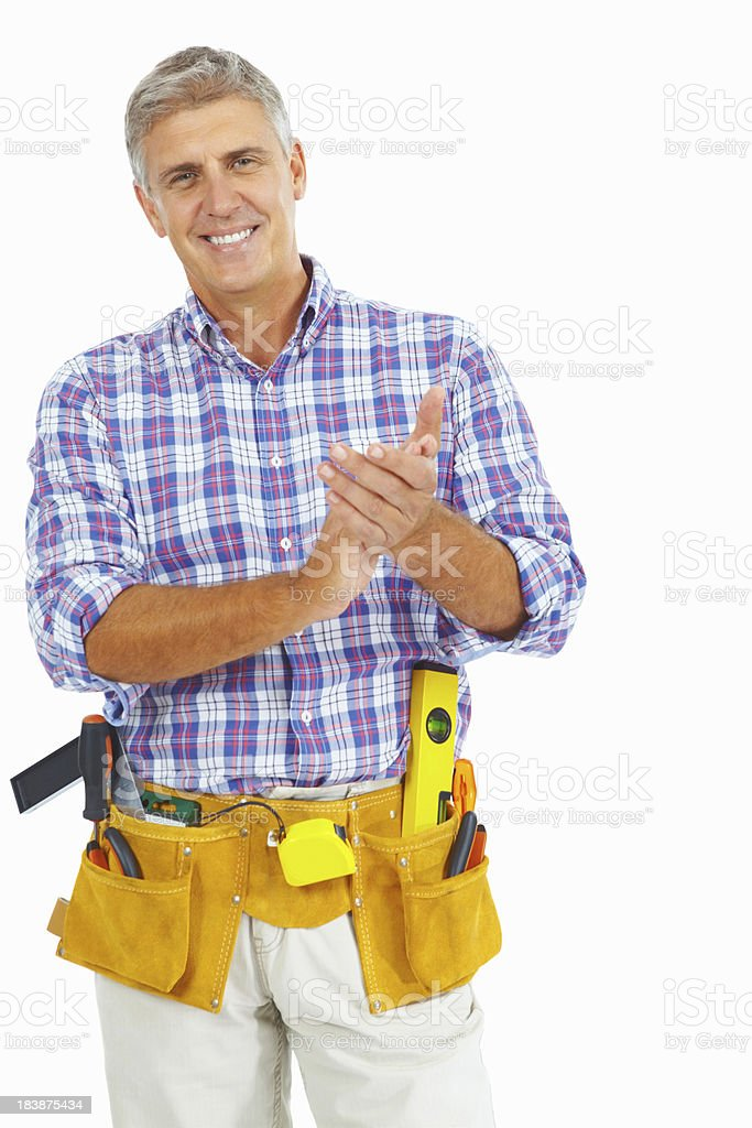 Mature carpenter with tool belt and hand gesture royalty-free stock photo
