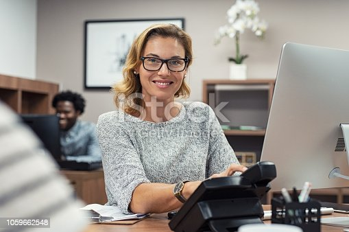 istock Mature casual woman working on computer 1059662548
