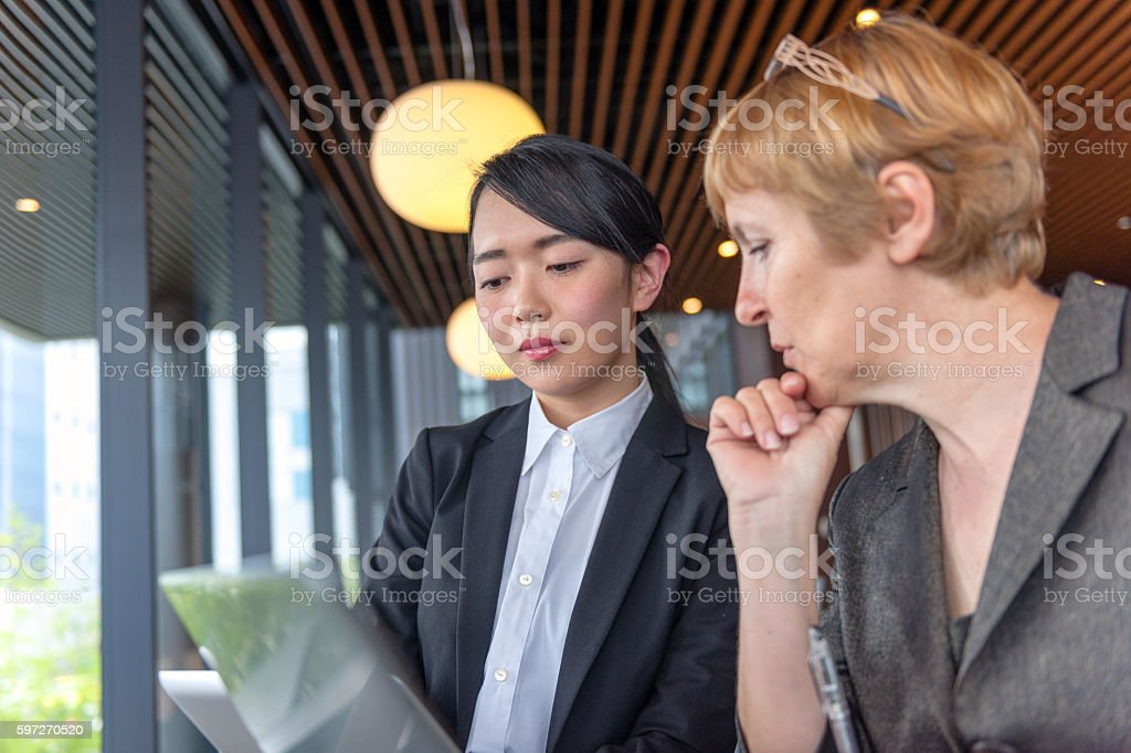 Mature Caucasian Businesswoman and Young Japanese Entrepreneur, Kyoto, Japan royalty-free stock photo
