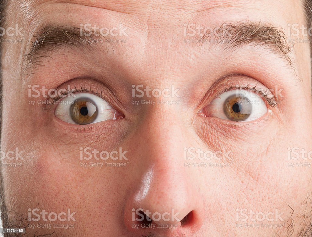 Mature Caucasian man, closeup, surprised look stock photo