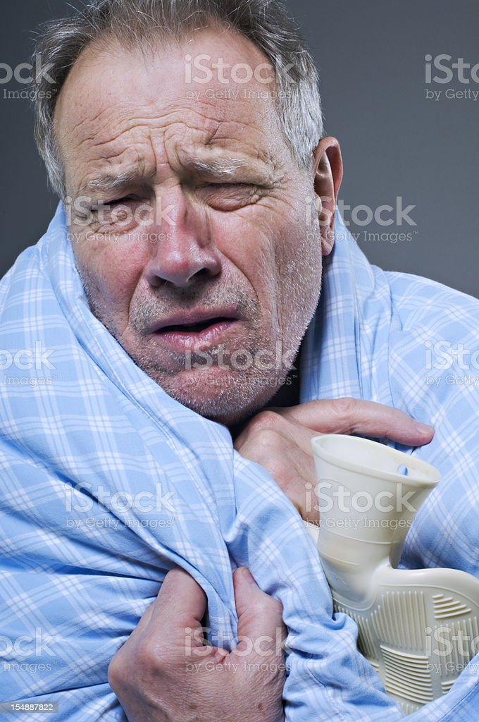 Mature Caucasian Man Suffering From A Cold or Man Flu stock photo