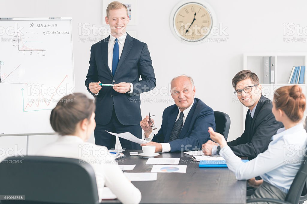 Mature CEO meeting his managers stock photo