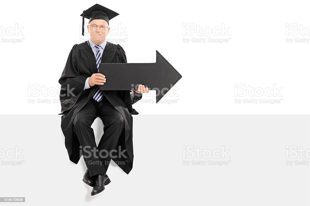 Mature college professor holding an arrow stock photo