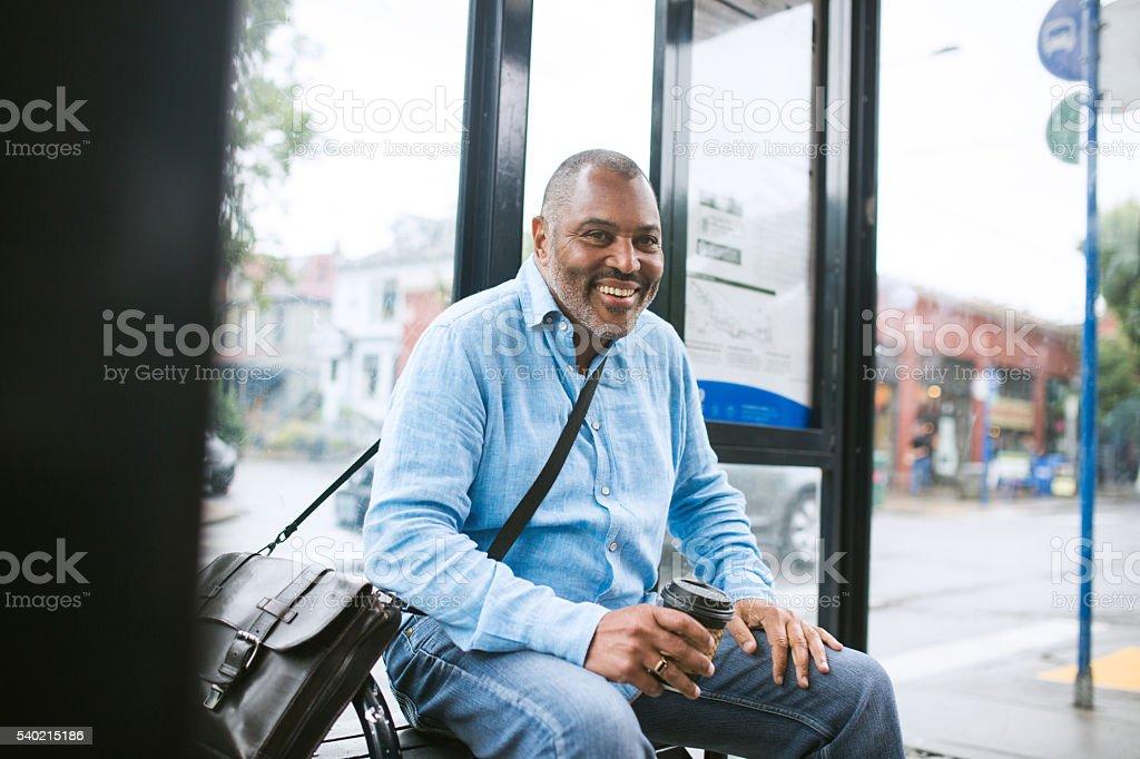 Mature Commuter Taking Public Transit stock photo