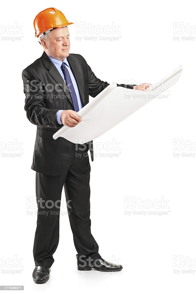 Mature construction worker with helmet holding blueprint royalty-free stock photo