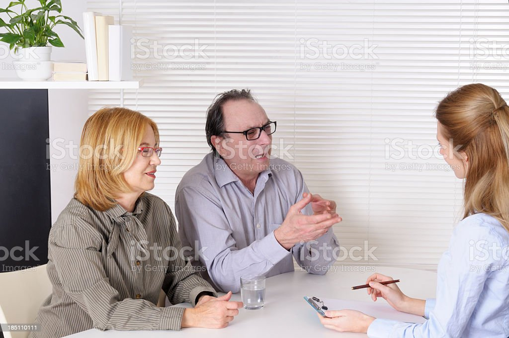 Mature Couple and Counselor royalty-free stock photo