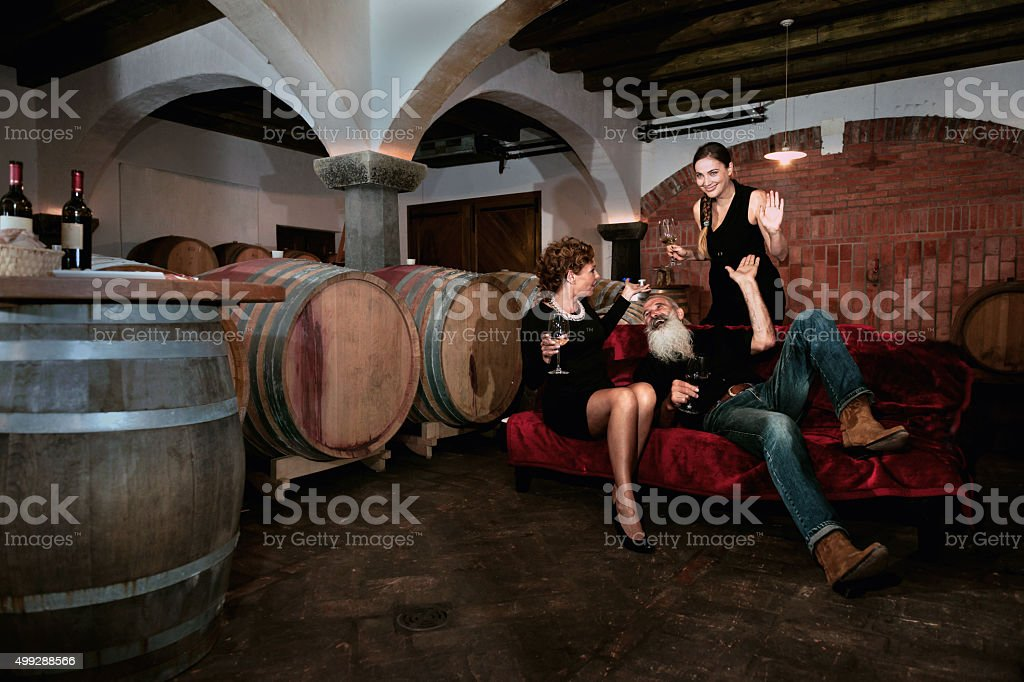 Mature Couple and Young Woman Enjoying, Cellar in Slovenia stock photo