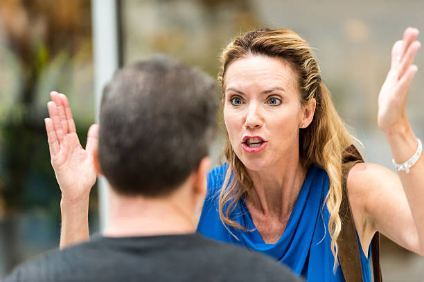 mature couple arguing - row of heads stock photos and pictures