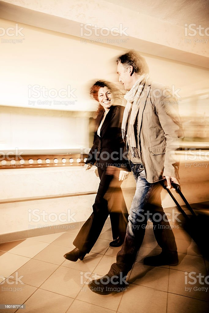 Mature couple arriving at the hotel royalty-free stock photo
