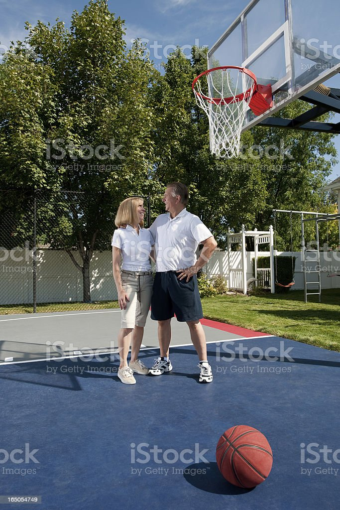 Mature Couple At Basketball Park stock photo