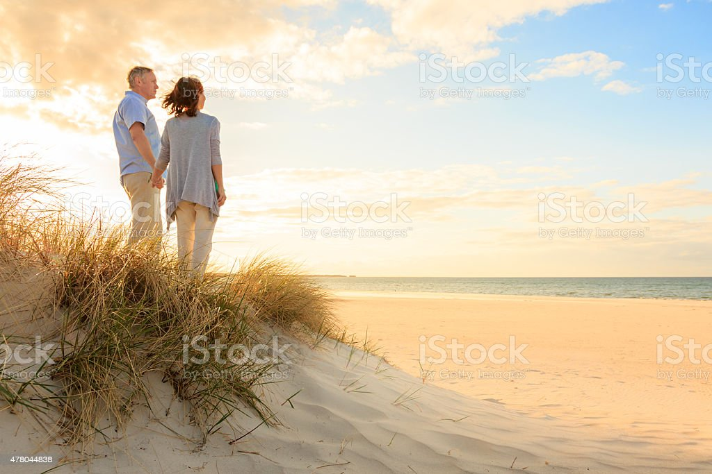 Mature couple at beach stock photo