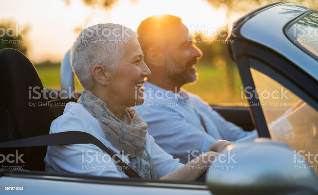 Mature couple at car stock photo