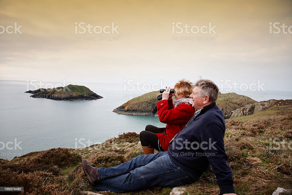 Mature couple at Strumble Head lighthouse royalty-free stock photo