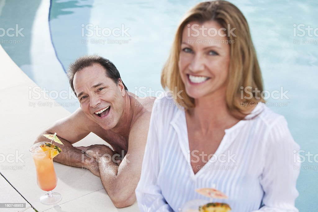 Mature couple at swimming pool royalty-free stock photo