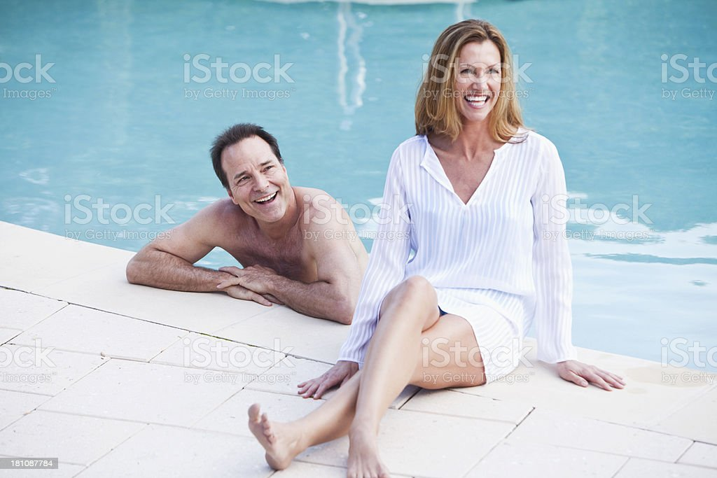 Mature couple at swimming pool stock photo