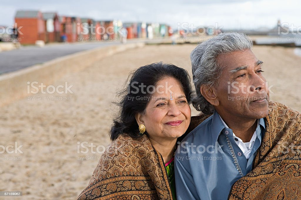 Mature couple at the beach stock photo