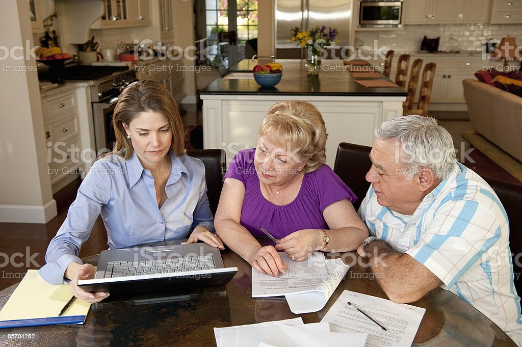 Mature Couple Budgeting with Financial Advisor royalty-free stock photo