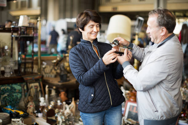 Mature couple buying antique things at the fleamarket stock photo
