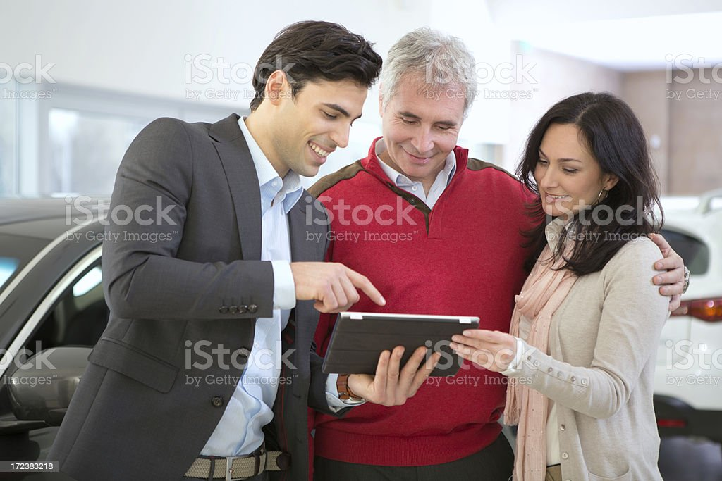 Mature couple buying car stock photo
