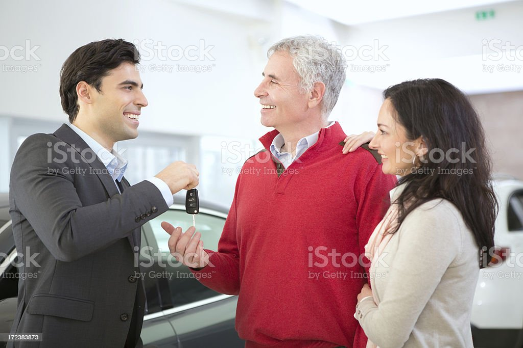 Mature couple buying car royalty-free stock photo