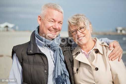 452783143 istock photo Mature couple by the sea. 514879987