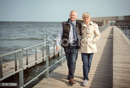 452783143 istock photo Mature couple by the sea. 516115355