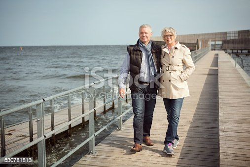 452783143 istock photo Mature couple by the sea. 530781813