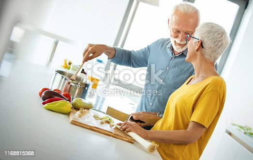 istock Mature couple cooking lunch together. 1168815368