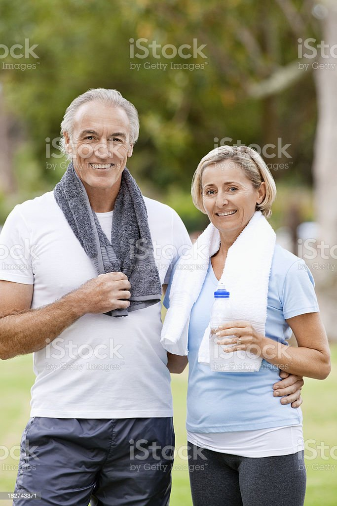 Mature Couple Cooling Off After Workout royalty-free stock photo